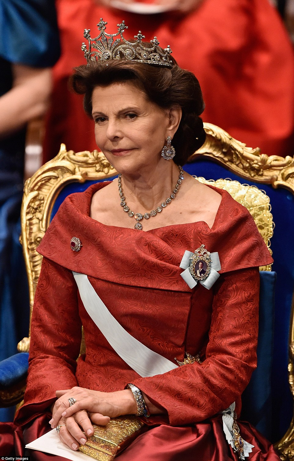 Queen Silvia glittered in her diamond tiara, earrings, necklace, rings and bracelet during the ceremony