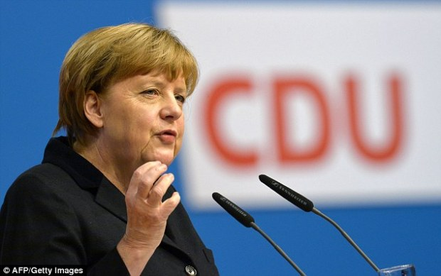German Chancellor Angela Merkel told her party faithful Germany would be 'overwhelmed in the long run' unless the numbers of refugees entering the country were significantly reduced