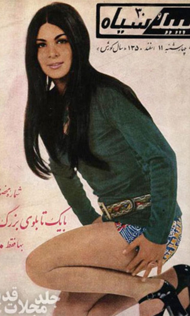 A woman in tight shorts and a belt around her waist wears Seventies style hair in a sleek centre-parting