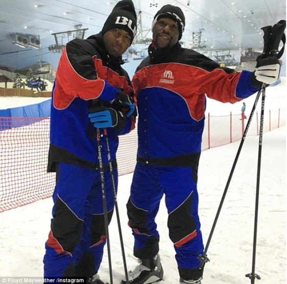 Floyd Mayweather (right) and long time friend James 'P-Reala' McNair pose on the slopes in Dubai