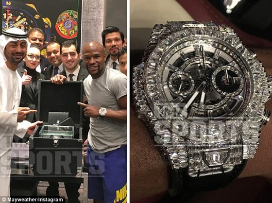 Mayweather shows off his $1.1million (£726,218) diamond-encrusted Hublot watch he bought in Dubai