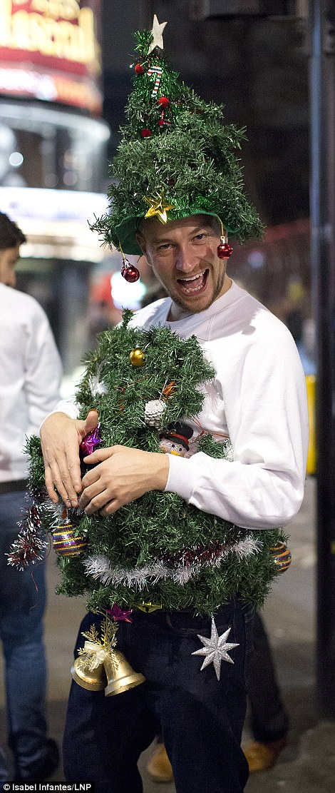 A man is dressed as a Christmas tree in central Lodnon