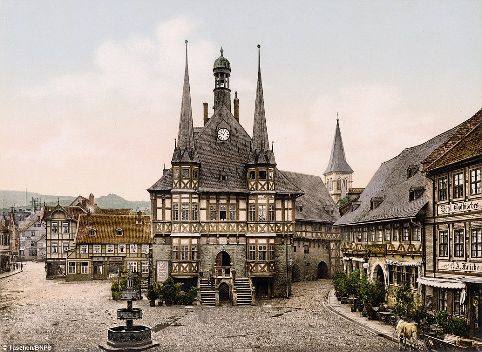 The wonderful colour in this photograph of Wernigerode Town Hall, pictured, brings the town centre to life in a time before cars