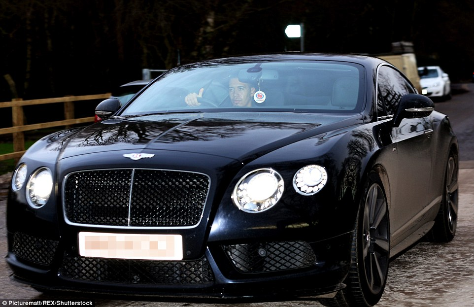 Defender Chris Smalling rolls into Carrington in his sporty Bentley following United's 2-1 defeat by Norwich on Saturday