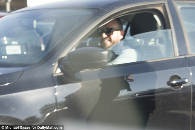 All smiles: Oscar Romero's speeds away in a parking lot in Ontario, California on December 19, 2015. Romero is the boyfriend of Mariya Chernykh, who was previously in a sham marriage with Enrique Marquez, the man who purchased two guns for the San Bernardino shooters