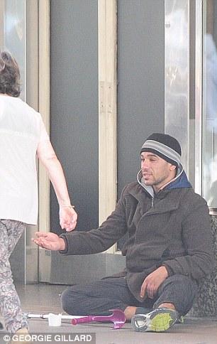 Hand out: Petru begging outside Selfridges