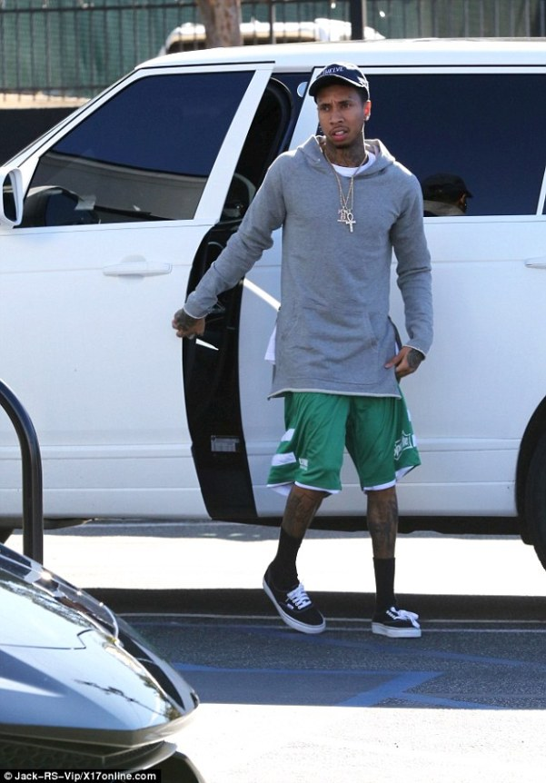 Christmas is - all about presents for me! Tyga was seen at a Lamborghini dealership on Wednesday