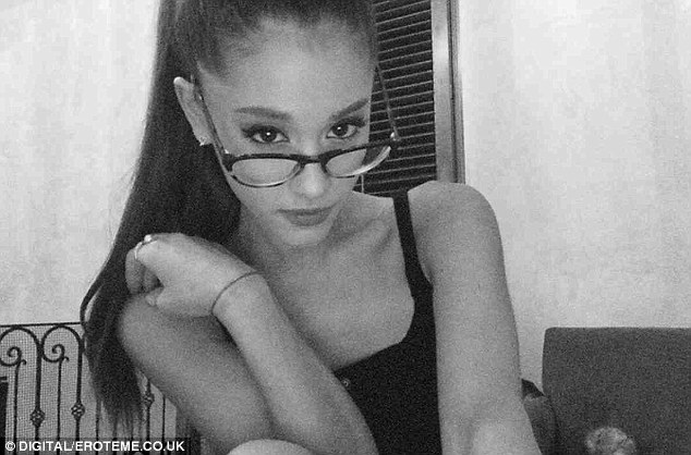 Strike a pose! Selfie queen Ariana Grande opted for a more risque shot on Wednesday as the 22-year-old shared a sexy librarian style snap to Instagram