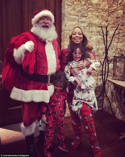 Special visit: The singer and her twins Monroe and Moroccan got a visit from Santa Claus on Christmas Eve in the ski resort