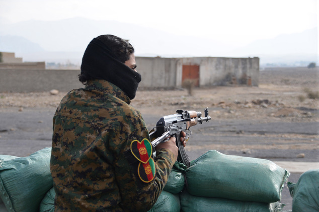 Violence: ISIS has a presence in other volatile regions of Afghanistan, but Nangarhar appears to be their main powerbase. Pictured, an Afghan militia man stands guard in the Achin district of Nangarhar province