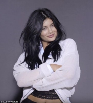 Baring her midriff: For once, Kylie let her natural beauty shine through with minimal make-up, thanks to the subtlety of artist Pati Dubroff