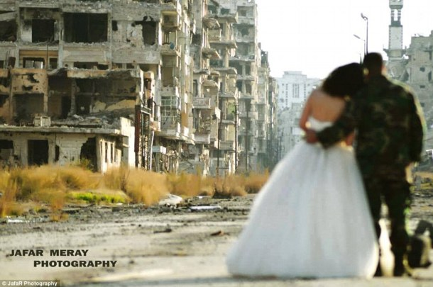 Surrounded by devastation: This bride and groom posed for a remarkable photoshoot following their wedding in the Syrian city of Homs