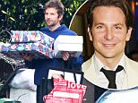 UK CLIENTS MUST CREDIT: AKM-GSI ONLYnEXCLUSIVE: Malibu, CA - 'Joy' star Bradley Cooper carries a bunch of Christmas gifts and a few bags as his friend stops by his place on this Monday afternoon. Dressing down, the scruffy actor wore a navy blue hoodie with matching trousers and brown leather shoes.nnPictured: Bradley CoopernRef: SPL1201673  291215   EXCLUSIVEnPicture by: AKM-GSI / Splash Newsnn
