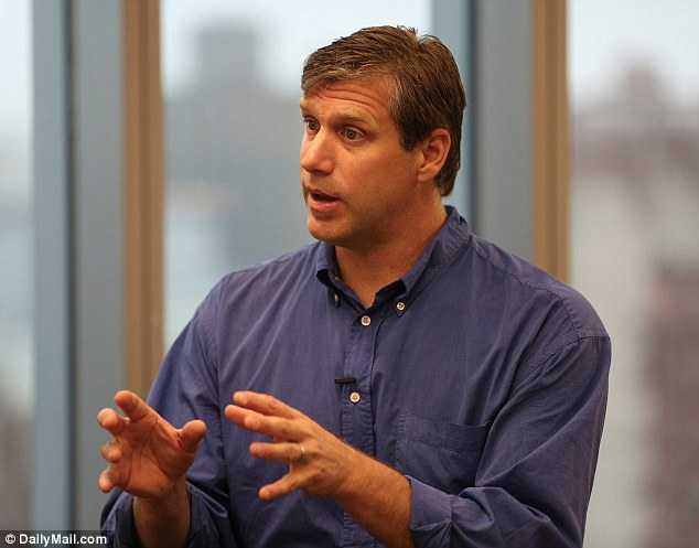Officials from the US Navy met with US presidential candidate and 'transhumanist' Zoltan Istvan to discuss the 'merger of humans and machines'. Mr Zoltan (pictured) said they were keen to draw up policies about microchip implants that can be used to track and carry information inside the human body