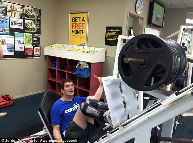 Mr Milroy working out. The 25-year-old with Cerebral Palsy has set himself the goal of climbing the world's tallest towers