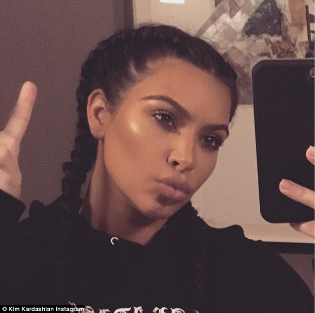 'To 2015!' Kim shared yet more selfies on Instagram after spending NYE playing board games with Caitlyn Jenner and Kourtney