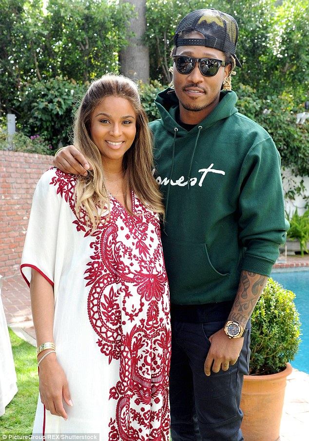 Ouch: Future does not seem pleased about access to his 20-month-old child as he blasted his former fiancée Ciara - as they are pictured together in LA back in March 2014 - on social media on Monday