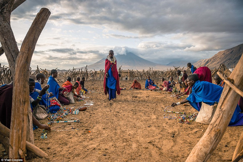 Adorned in an array of necklaces and with lobes stretched almost to their shoulders, the Maasai people were extremely welcoming to the 30-year-old Romanian. Pictured are Maasai women selling their handcrafts in the village stall