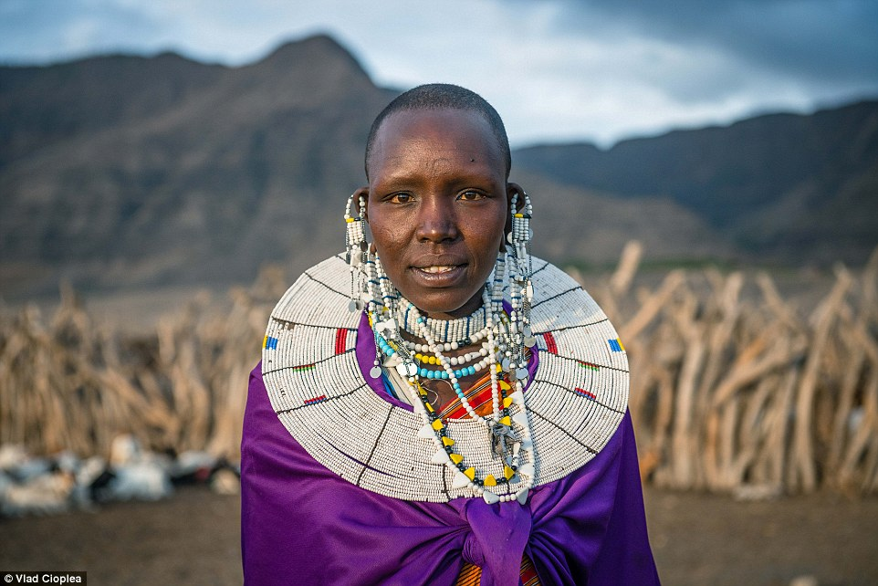 In Maasai tribes, boys between seven and 14 years are circumcised and then they have to leave their homes for at least three months to learn how to survive on their own in the wilderness. Pictured is Maria, a Maasai woman from Natron Lake Village