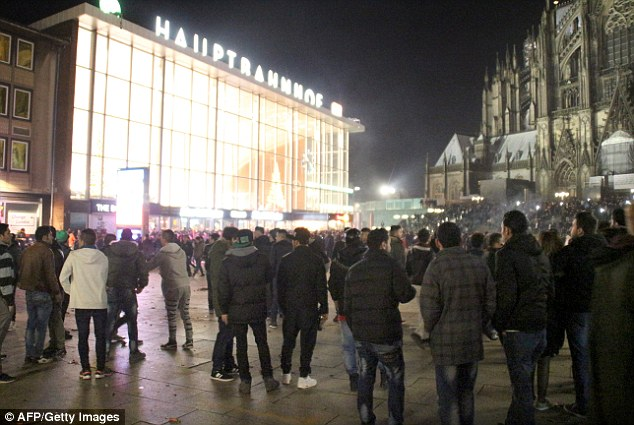 Hundreds of people gather in front of Cologne's main railway station, where disorder broke out last week and groups of 'Arab or North African' men attacked dozens of women