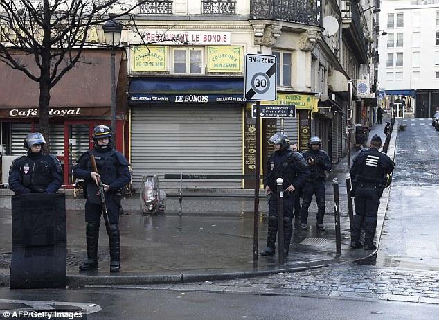 Na cena: Autoridades francesas dizem que o homem estava vestindo o que parece ter sido um colete de explosivos ou cinto, e a polícia está investigando o ataque como potencial terrorismo
