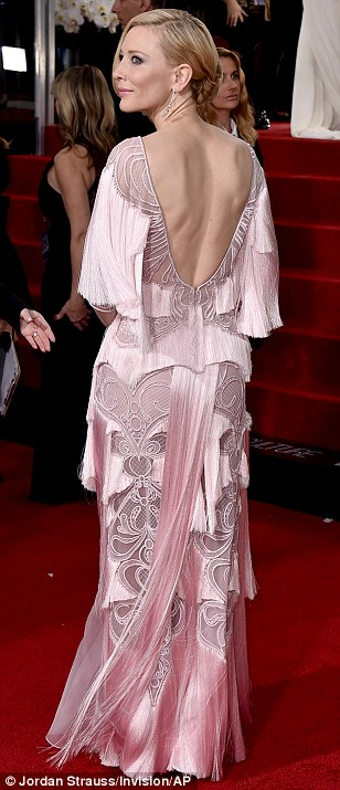 Vintage vixen: Cate Blanchett showed off the fringing on her pink 1920s style dress as she walked the red carpet