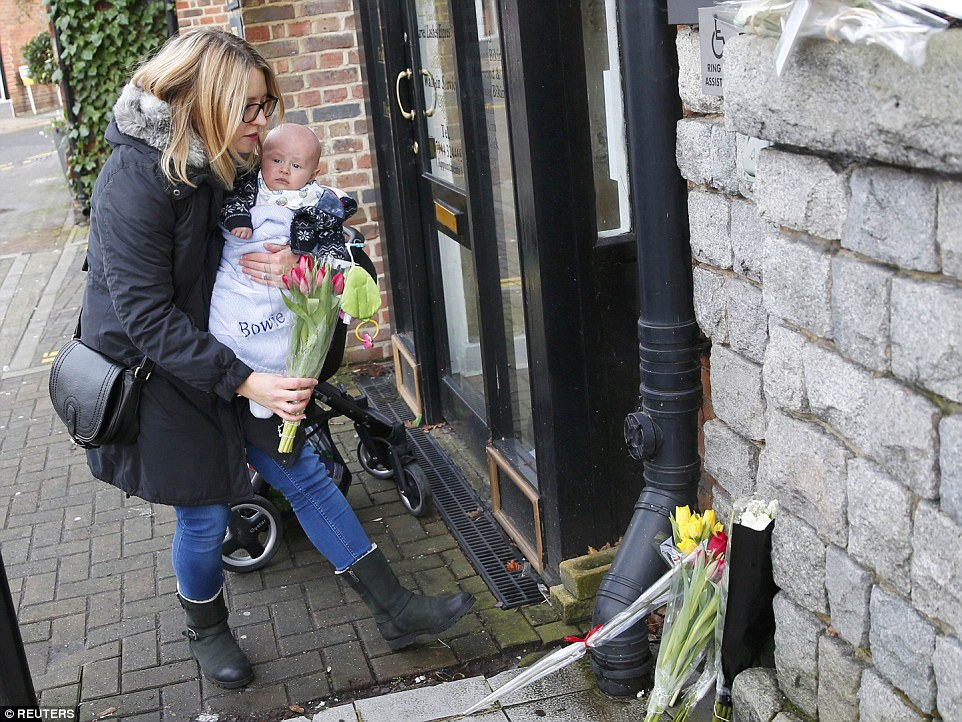 Dedicated: Emma Birch with her son Bowie at the Three Tuns pub in Bromley, South-East London, where the star used to perform