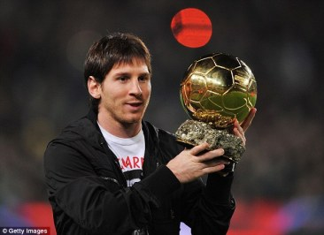 Messi poses with the Ballon d'Or award for the first time, fresh-faced, out on the Nou Camp pitch in 2009