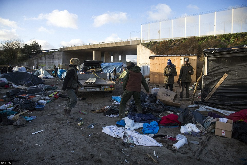 Tents and other belongings have been left strewn across the ground as migrants attempt to clear the camp before it is bulldozed