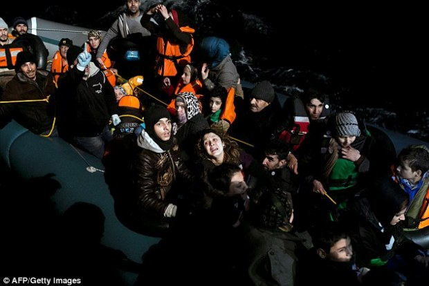 Refugees and migrants aboard an inflatable dinghy about to be rescued by MOAS (Migrant Offshore Aid Station) while attempting to reach the Greek island of Agathonisi on Saturday