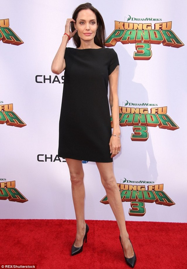Showstopper: Angelina donned a black Saint Laurent dress, pairing the simple frock with matching pumps