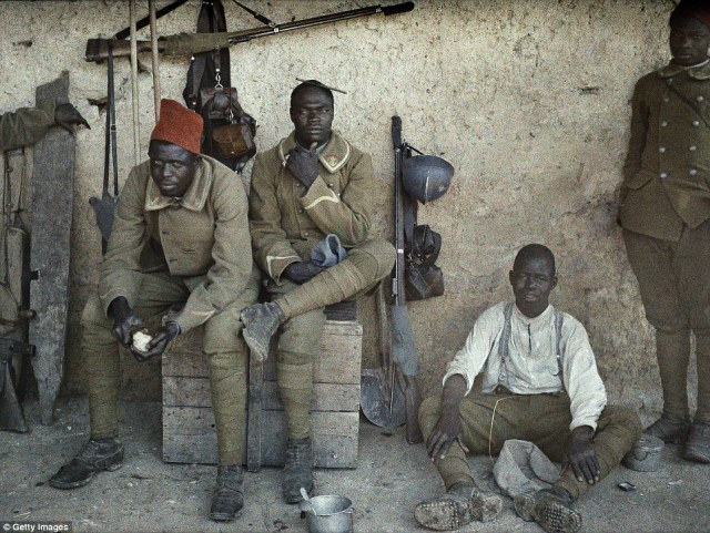 Senegalese soldiers serving in the French Army as infantrymen rest in a room surrounded by weapons in Saint-Ulrich, France on 16 June