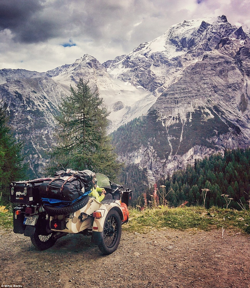 The family transported all of their belongings and tent on the back of their side car, which cost around£10,660 to buy. Pictured isStelvio Pass (Italy)