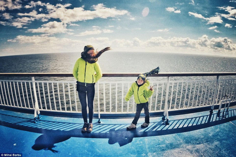 Matching outfits: Vladimir and his mother wear the same green jacket on the ferry from Tallin in Estonia to Helsinki in Finland