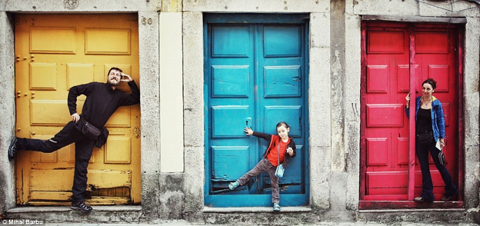 The fun trio pose next to some brightly coloured doors in Porto in Portugal