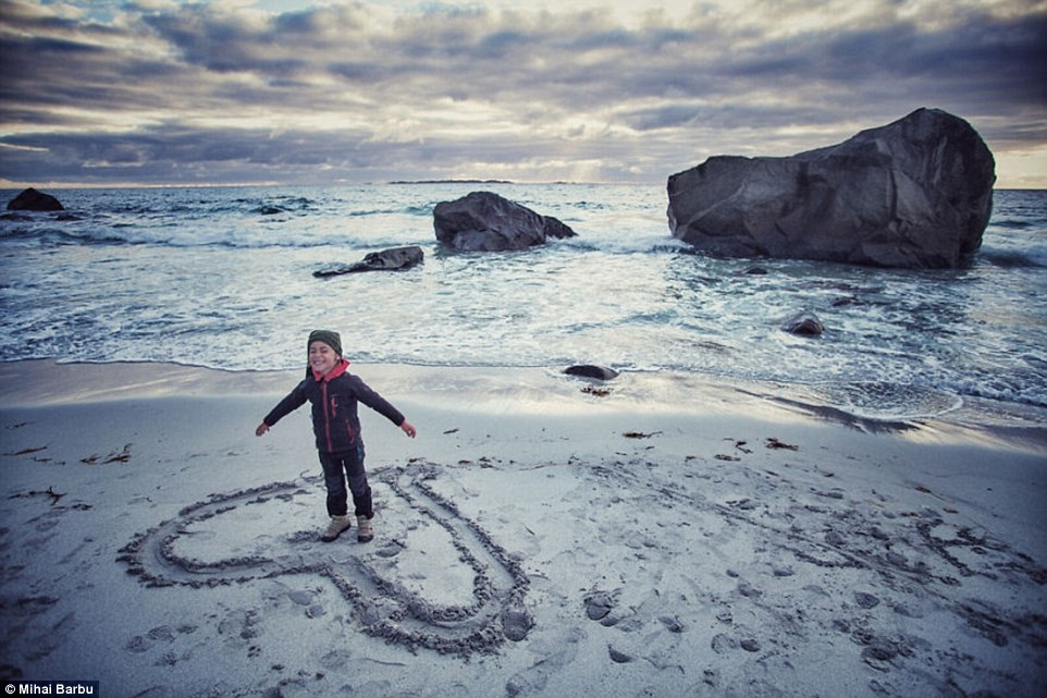 Love in the Lofoten Islands in Norway: The family played on beach during their epic four-month expedition