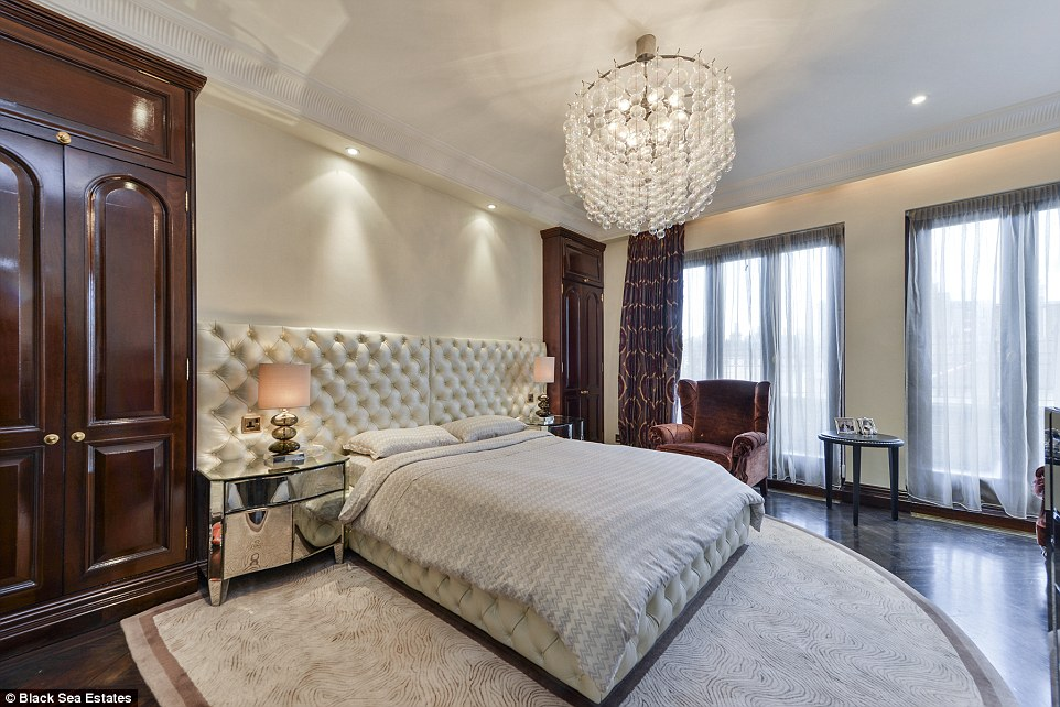 On the upper two floors are the four bedrooms and four bathrooms, with an additional terrace off the master suite. Subtle taupe tones and dark wood create a classy color palette throughout the luxurious home