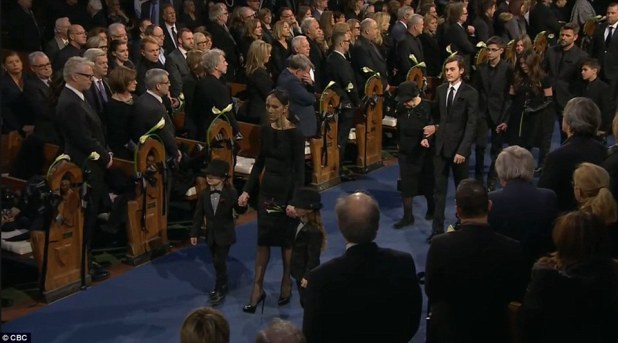Composed: Celine Dion kept remarkable composure while arriving to the funeral holding the hands of her youngest sons
