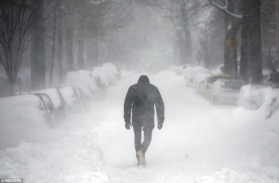 Image result for man walking in snow blizzard
