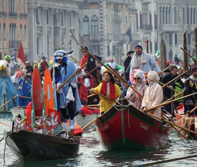 By Venice Tradition Elaborately Costumed Carnival Goers Stroll Through The Canal Laced City