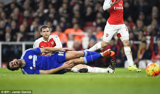 Per Mertesacker was shown a straight red card by Clattenburg after he swiped the legs of Costa