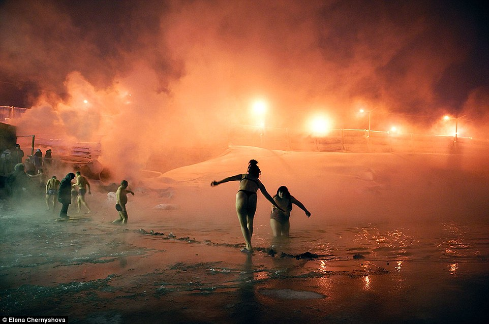 The Norilsk's citizens suffer 'the polar night syndrome', resulting in anxiety, nervousness, drowsiness or insomnia, depending of the seasons, while the psychological discomfort and poor emotional stimuli also generate many cases of depression. Pictured in January locals celebrate Epiphany by swimming in Lake Norilsk
