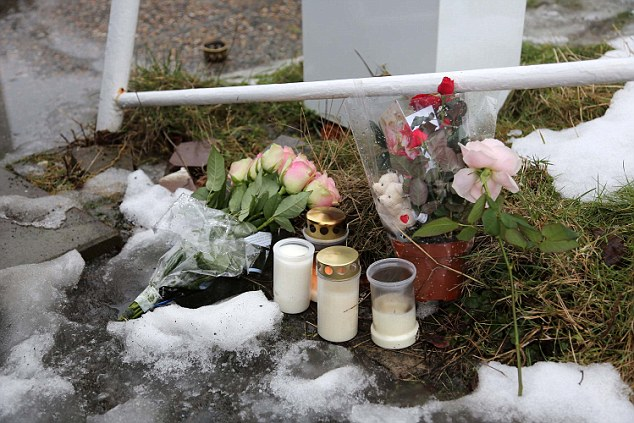 Tribute: Flowers and candles have been left outside the housing for unaccompanied migrants in Molndal, near Gothenburg, where Miss Mezher was killed