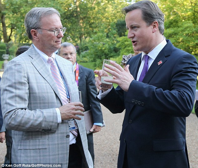 Former Google CEO and now executive chairman Eric Schmidt chats to Prime Minister David Cameron at a drinks reception - and has in the past advised Cameron on economic matters