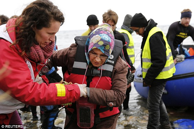 A volunteer helps a woman out of the boat that arrived on Lesbos on Friday.The data from Sweden emerged less than a month after a number of German cities saw a wave of sex attacks and mob violence, with the majority of suspects of North African origin