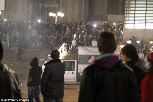 There is 'no link' between the migrant crisis and the wave of sex attacks in Cologne during New Year celebrations, EU officials believe. Above, a large group gathers outside Cologne train station days after the attacks