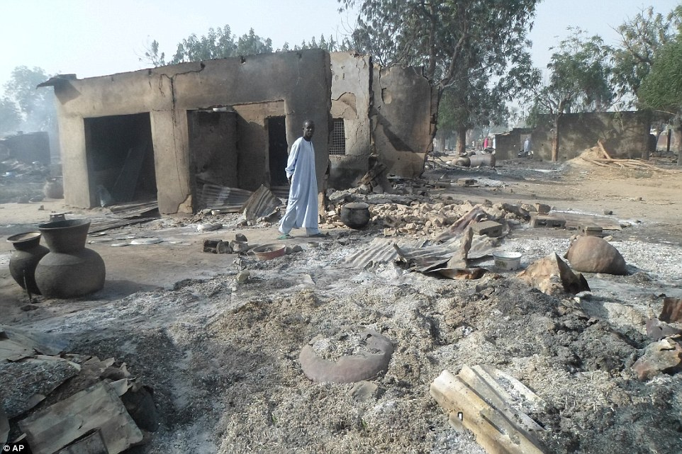Attack: More than 50 villagers, including children, lost their lives when the terrorists stormed through the streets late on Sunday night