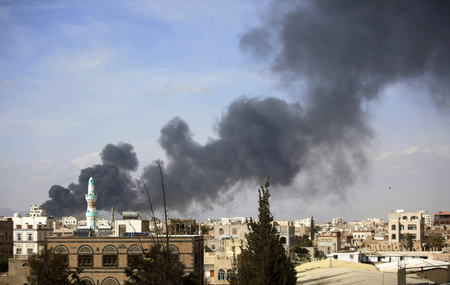 Smoke rises after Saudi-led airstrikes hit a site in Sanaa, Yemen, Saturday, Jan. 30, 2016. Airstrikes by the Saudi-led coalition targeting Yemen's Shiite re...