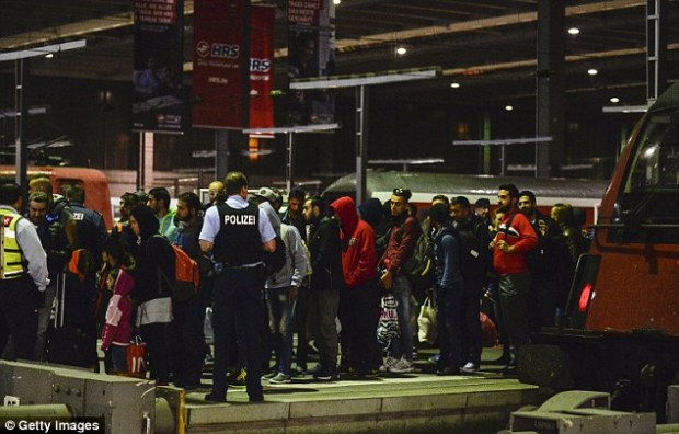 Uprising: The incident is the latest violent incident between German residents and asylum-seekers in recent weeks. Pictured, migrants and refugees are seen arriving by train at Munich Hauptbahnhof railway station on September 12 last year