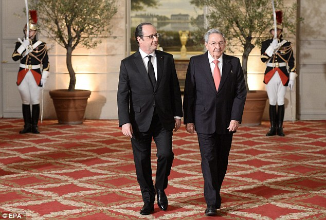 Historic:French President Francois Hollande (left) and Cuban President Raul Castro (right) arriving for the state dinner on Monday evening